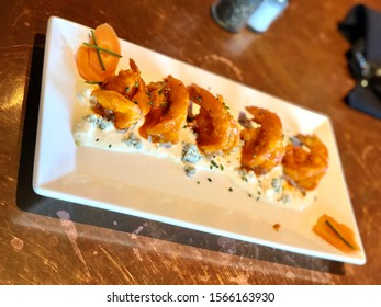 Bang Bang Firecracker Shrimp Prawn Apperizer with Spicy Buffalo Sauce and Blue Cheese on Long White Plate