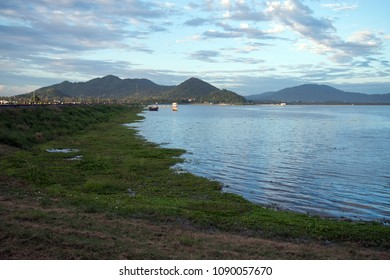 The Bang Phra reservoir with scattered clouds and the mountains in the background, Sri Racha, Chonburi, Thailand