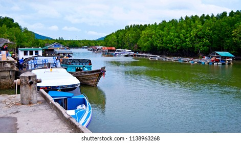Bang Rong, Thailand - October 15, 2014: The Bang Rong pier, located in an estuary surrounded by a mangrove forest, on the northeast side of Phuket island.