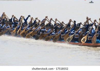 Bang Sai, Ayuttaya, 14 September 2008: Two traditional Thai Long Boats with a crew of 55, competing on the Chao Praya river during the Long Boat Race Championship at Bang Sai, Ayutthaya in Thailand.