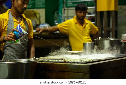 BANGALORE, BENGALURU, KARNATAKA, INDIA, FEBRUARY 18, 2018: Preparing masala uthappam in a street shop from Bangalore food street, Bengaluru, Karnataka.