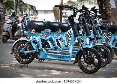 Bangalore or Bengaluru, Karnataka, India-January 15 2021: A group of Yulu Miracle electric bikes or bicycles or scooters or cycles are parked on a road side street for rentals.