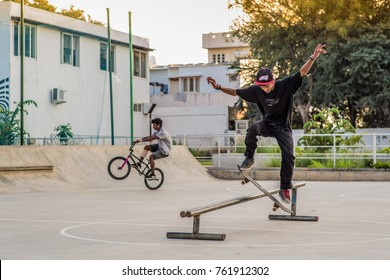 Bangalore / India -11-20-2013: A skateboarder and BMX rider in a skatepark.