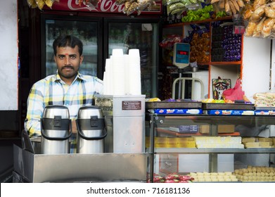 BANGALORE, INDIA - APRIL 12, 2016: A man selling chai (indian tea) standing at his shop in the train station