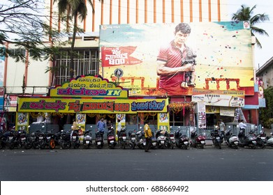 BANGALORE, INDIA - APRIL 13, 2016: the big theater in bangalore with many motorbikes parking in line queuing to see the film