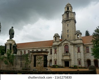 BANGALORE, INDIA, AUGUST 18, 2018: Facade of the main administrative building of the Indian Institute of Science (IISc) and the statue of the founder, JN Tata.