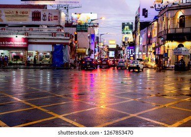 Bangalore, India - CIRCA Jun 2018 : A evening view of MG Road in the central business district, light reflections are seen due to rain.