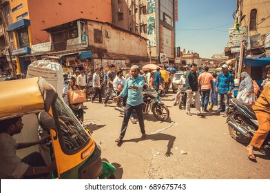BANGALORE, INDIA - FEB 12: Panic on street with crowd of busy people and vehicles, making traffic jam on February 12, 2017. Capital of the state Karnataka has a population of 8.42 million
