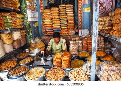 BANGALORE, INDIA - FEB 12: Trader inside a sweets store selling tasty biscuits and snacks on February 12, 2017. Capital of the state Karnataka has a population of 8.42 million