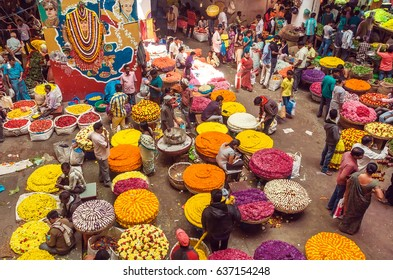BANGALORE, INDIA - FEB 14: Customers and traders of huge Flower Market on busy indian street on February 14, 2017. With population 8.52 million, Bangalore is 3rd most populous indian city