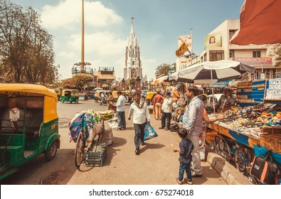 BANGALORE, INDIA - FEB 14: Market street with autos, clothing stores and rushing customers on February 14, 2017. With popul. 8.52 million, Bangalore is third most populous indian city