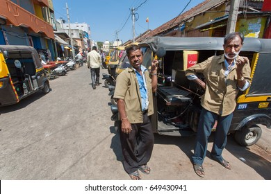 BANGALORE, INDIA - FEB 14: Two drivers of traditional indian taxi autorickshaw waiting for customers on February 14 2017. With population 8.52 million, Bangalore is the third most populous indian city