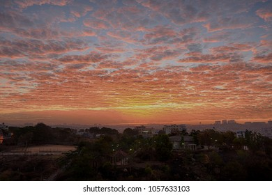 Bangalore , India - February 28 , 2018 : Beautiful cloud formation and hide and seek of sunrise within these clouds in South Bangalore