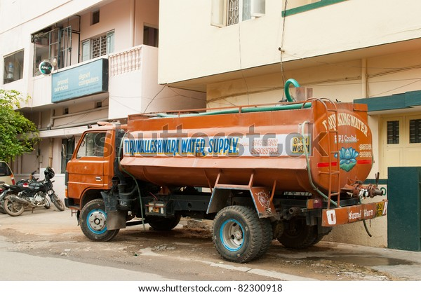 BANGALORE, INDIA - JULY 15: A water tanker supplies water to a home on July 15, 2011 in Bangalore. Many parts of urban India are experiencing acute water shortage as cities expand rapidly.