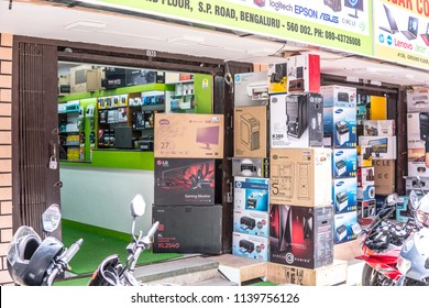 Bangalore, India, June 03, 2018, Bengaluru city, Sadar Patrappa Road, local electronic market with computers, Hindus Indians doing shopping, narrow crowded street,