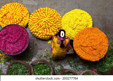 BANGALORE, INDIA - June 06: Woman selling ropes of flowers at KR Market in Bangalore. June 06, 2014 in Bangalore, India.