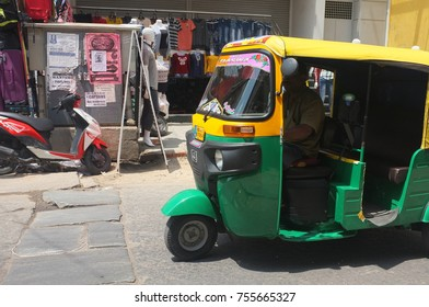 Bangalore, India - March 4, 2017 : Auto Rickshaw or locally known as tuk tuk is a famous light public transport to travel at near distance in India
