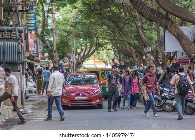 Bangalore / India - May 28 2016: A busy street in downtown Bangalore on a late afternoon.