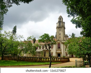 BANGALORE, KARNATAKA, INDIA, AUGUST 18, 2018: The main administrative building of the Indian Institute of Science (IISc) and the statue of the founder, JN Tata.