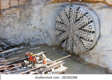 Bangalore, Karnataka, India - February 25, 2013: Tunnel boring machine on construction site building metro