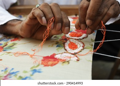 Bangalore, Karnataka, India - March 18, 2014: Unidentified man embroidering cloth in traditional method of India, Closeup