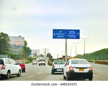 BANGALORE, KARNATAKA, INDIA, MAY 04, 2017: Road sign. Big blue sign board giving directions to the airport and Hyderabad/Devanahalli.