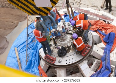 Bangalore, Karnataka, India - November 23, 2006: Tunnel Boring Machine being assembled