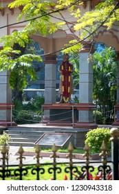 BANGALORE, KARNATAKA, INDIA - OCTOBER 20, 2018: A street scene in Bangalore (Bengaluru), with a statue of Swami Vivekananda, an Indian Hindu monk.