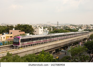 Bangalore, Karnataka India-June 01 2019 : Aerial View Bengaluru metro moving on the bridge near Vijaya Nagara, Bengaluru , India.