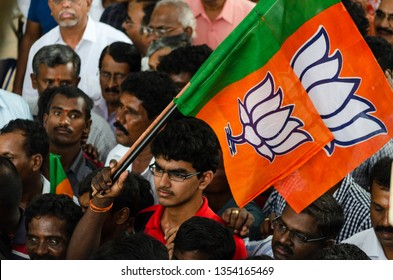 Bangalore /Karnataka/INDIA - 9 April 2015 : Large crowd walking & holding BJP flags to enter the public meeting held by  BJP on 9th April in Bangalore India.