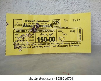Bangalore, Karnataka/India-Mar 03 2019: Akash Cinemas 2K Digital A/C Yellow color gold class movie ticket isolated in a white background