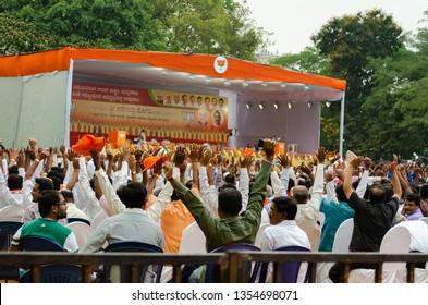 Bangalore/Karnataka/India:09 April 2015 :BJP supporters and public crowd raising their hands during a  public meeting held by Narendra Modi in Bangalore Karnataka India.