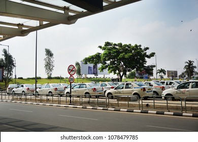 BANGALURU, KARNATAKA, INDIA, APRIL 22, 2018: Taxi stand with rows of cars at the Kempegowda International Airport, on a bright sunny day.