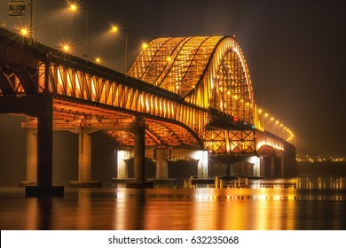 banghwa bridge at night over the han river in seoul, south korea