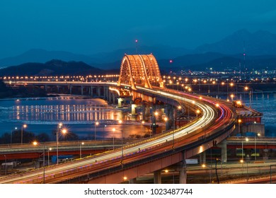 Banghwa bridge, over Han-River, Seoul, Korea: The bridge is located at the west side of Han-river, which runs through the heart of capital Seoul. It is famous for its brilliant red lightings. It conne