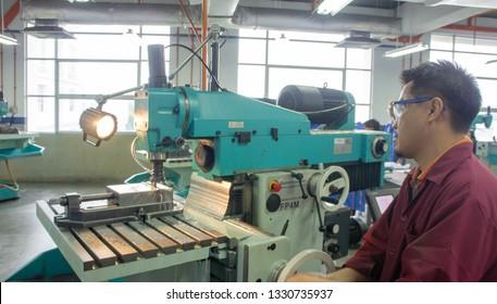BANGI,MALAYSIA- MARCH 5,2019: A machinist operate a milling machine in a machine shop.