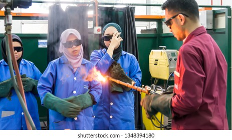 BANGI,MALAYSIA-FEBRUARY 14,2019: The male instructor is demonstrating gas welding process with the trainee in a metal workshop.