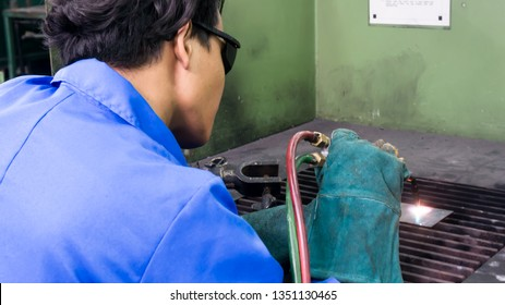 BANGI,MALAYSIA-FEBRUARY 14,2019: The male trainee is performing gas welding process in a metal workshop.