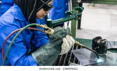 BANGI,MALAYSIA-FEBRUARY 14,2019: The unidentified trainee is performing gas welding process in a metal workshop.