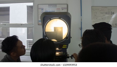 BANGI,MALAYSIA-MARCH 3,2019: A group of technical student learn the application of profile projector machine for part inspection.