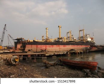 Bangkalan, Indonesia - 26/2/2014 : industrial destruction and cutting of old ship iron for resale