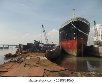 Bangkalan, Indonesia - 3/4/2014 : industrial destruction and cutting of old ship iron for resale