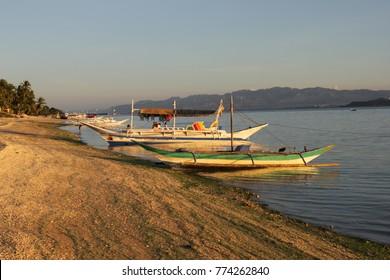 Bangkas in the Sunset, Carabao Island, Philippines