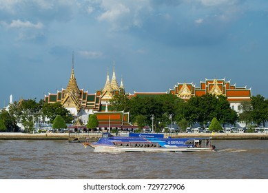 Bangkok - 13 August 2017 Passengers and tourists travel by boat on the Chao Phraya River near the Grand Palace on August 13, 2017 in Bangkok, Thailand