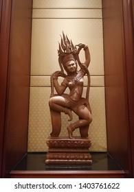 Bangkok, Thailand. May 17,2019: Wood carving is a woman dancing, Sculptor for decoration in the Prince Palace Hotel Bangkok, Thailand.