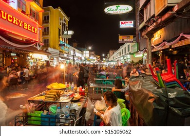 BANGKOK - 20 Oct 2016: Food stands, bars, and tourist shops line Khao San Road on October 20, 2016 in Bangkok