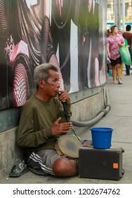 Bangkok - 2010: One man band busker along the streets of Bangkok