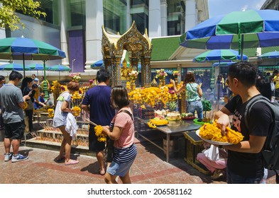 BANGKOK - 3  July 2014 : People pray respect the shrine of the four-faced Brahma statue at Ratchaprasong Junction on July 3, 2014 in Bangkok,Thailand.