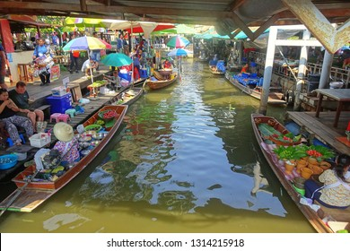 Bangkok, 8 February - 2019 Floating Market Taling Chan on February 8 - 2019 in Bangkok Locals selling food on rafts, fresh fruits and vegetables in a genuine atmosphere on the riverside