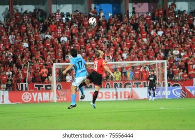 BANGKOK - APR 17 : M.Toth(red) in action during Thai Premier League (TPL) between Muang Thong utd (Red) vs SCG Samutsongkram Fc (Blue) on April 17, 2011 at Yamaha Stadium Bangkok, Thailand